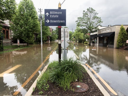 Lodge Street in Biltmore Village sits completely under water Wednesday, May 30, 2018, as a result of heavy rain throughout Western North Carolina.