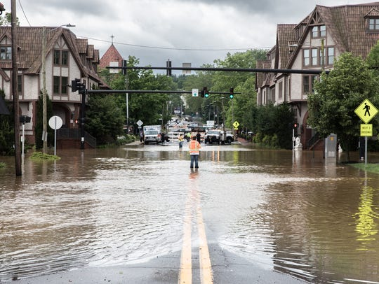 Biltmore Avenue is completely flooded Wednesday, May 30, 2018, as a result of heavy rain throughout Western North Carolina.