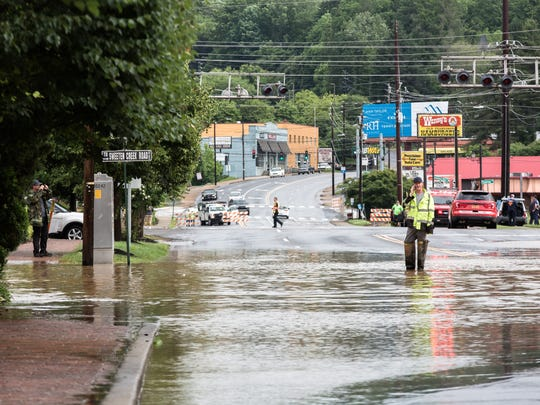 Biltmore Avenue is flooded as a result of heavy rain throughout Western North Carolina on Wednesday, May 30, 2018.