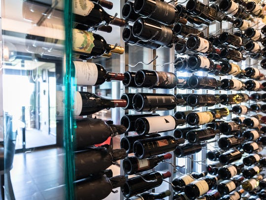 Stacked wine bottles in a chilled wine room on the