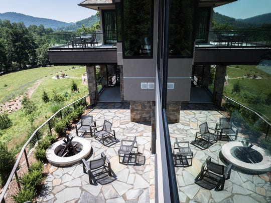 A look below at a patio and outdoor fire pit at the home of Marty and Peter Vexter at the Cliffs at Walnut Cove in Arden.