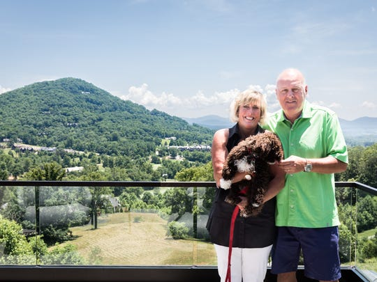 Marty Vexter and Peter Vexter at their home at the Cliffs at Walnut Cove in Arden with their dog Booker.