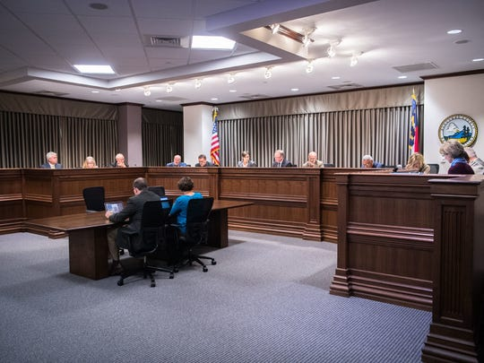 Buncombe County's Board of Commissioners voted 5-2 last week to not cut their own salaries. In this photo, commissioners meet on Oct. 17, 2017.