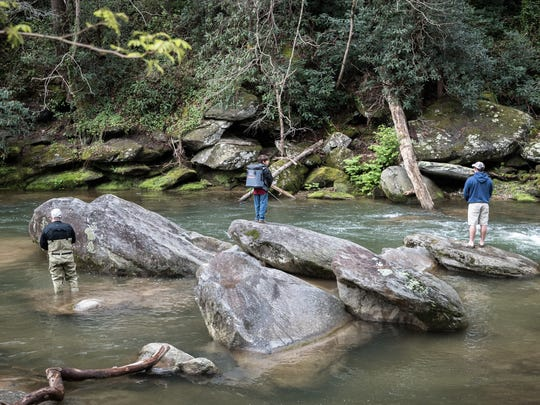 Fishermen fish in the Rocky Broad River in Chimney Rock on opening day of trout fishing season Saturday, April 7, 2018.