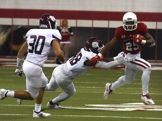 University of South Dakota's Canaan Brooks (25) runs