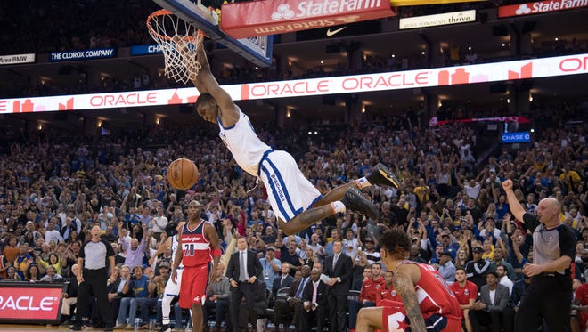 Golden State Warriors forward Kevon Looney (5) dunks the basketball against the Washington Wizards during the fourth quarter at Oracle Arena.