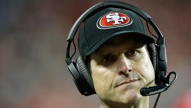 San Francisco 49ers coach Jim Harbaugh  looks on in the second half against the San Diego Chargers on Dec. 20, 2014, in Santa Clara, California.