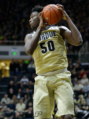 Purdue forward Caleb Swanigan (50) grabs a rebound against Youngstown State in the first half of an NCAA college basketball game in West Lafayette, Ind., Saturday, Dec. 12, 2015. (AP Photo/Michael Conroy)