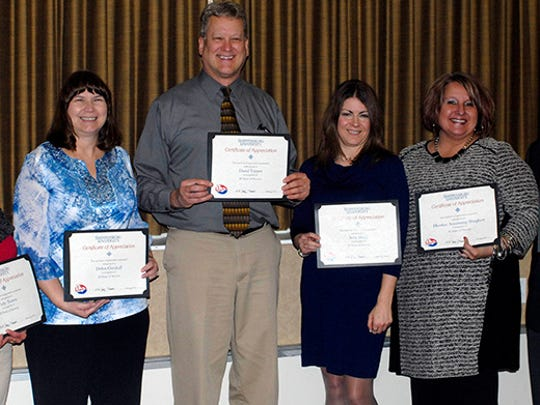 20-Year Service Award recipients Vicky Tosten, Debbie Gutshall, Dave Topper, Amy Diehl and Heather Armstrong-Shughart with President Jody Harpster.
