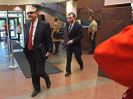 Attorney Leo Flynn walks into the Minnehaha County