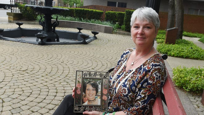Robin Buskirk holds a photo of her daughter, Katie Buskirk, who died in 2005 and was an organ donor. About 27 people benefited from Katie's donations.