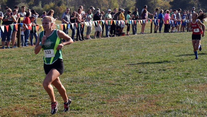 Wilson Memorial's Natalie Prye sprints to the finish line of the girls race at the Region 2A East cross country championships at Panorama Farms in Earlysville, Va., on Wednesday, Nov. 2, 2016.