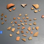 Assorted pottery sherds originally found on the surface of the Luna settlement, including Spanish olive jar, lead glazed coarse eartenware, majolica, incised and plan Native American pottery.