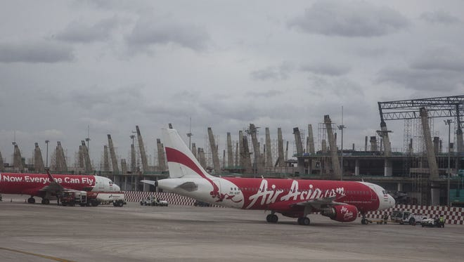 AirAsia planes are parked at Soekarno Hatta International Airport on Dec. 28, 2014 in Jakarta, Indonesia.