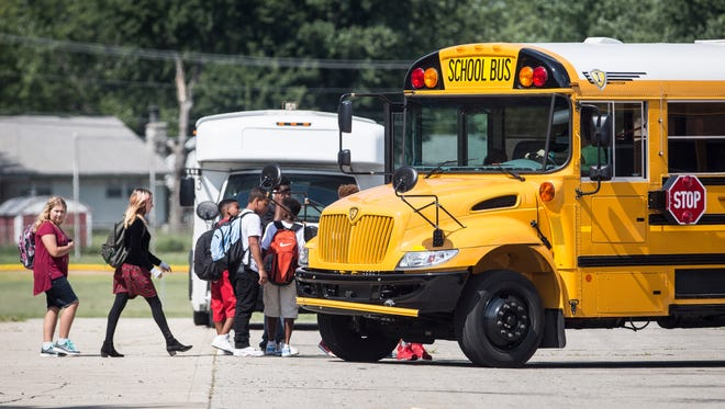 Students at Northside Middle School load onto buses nearly a half hour behind schedule on Aug. 2 at the Northside Middle School parking lot.