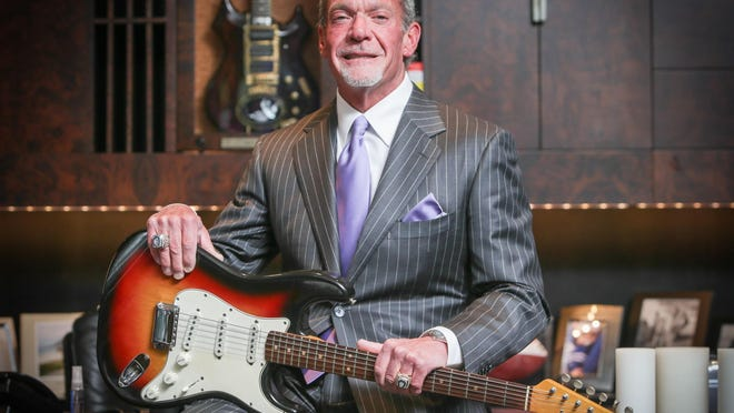Jim Irsay poses with the Dylan-at-Newport Fender Stratocaster in 2014.