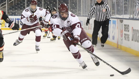 Mickey Burns of Don Bosco carrying the puck in the