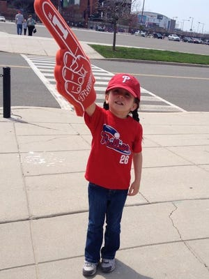 A young Phillies fan whose mother shall remain nameless shows off her foam finger in the Citizens Bank Park parking lot.