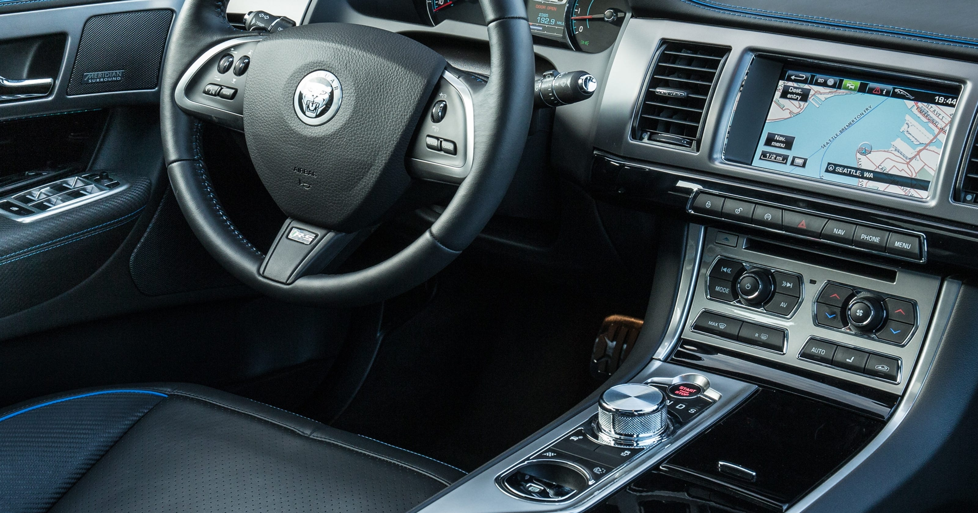 Among bells and whistles, cars shift to buttons, knobs