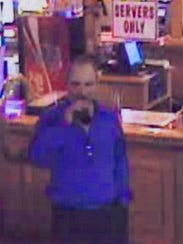 Surveillance photo of a suspect in death of Michael