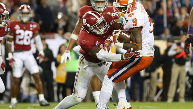 FILE--  Alabama Crimson Tide linebacker Reuben Foster (10) tackles Clemson Tigers running back Wayne Gallman (9 in the 2017 College Football Playoff National Championship Game at Raymond James Stadium.