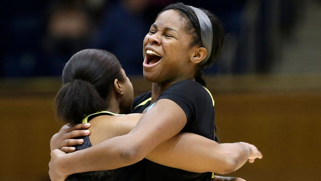 Oregon's Ruthy Hebard, right, hugs Oti Gildon following a second-round win against Duke.