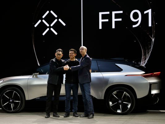 Senior Vice President Of Product Research Development Right And Richard Kim Design After Unveiling The Ff91 Electric Car