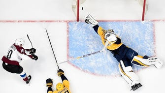 Colorado Avalanche right wing Sven Andrighetto (10) scores the game-winning goal past Nashville Predators goaltender Pekka Rinne (35) during the third period of game 5 in the first round NHL Stanley Cup Playoffs at Bridgestone Arena, Friday, April 20, 2018, in Nashville, Tenn.