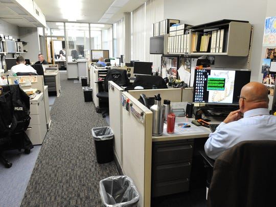 Salinas police officers frequently share limited desk space.