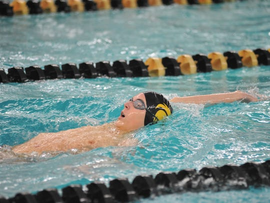 Colonel Crawford's Kyle Taylor swims the 100 backstroke.