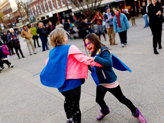 Kids dance during a Big Ears square dance performance in Market Square in Knoxville, Tennessee on Thursday, March 22, 2018.