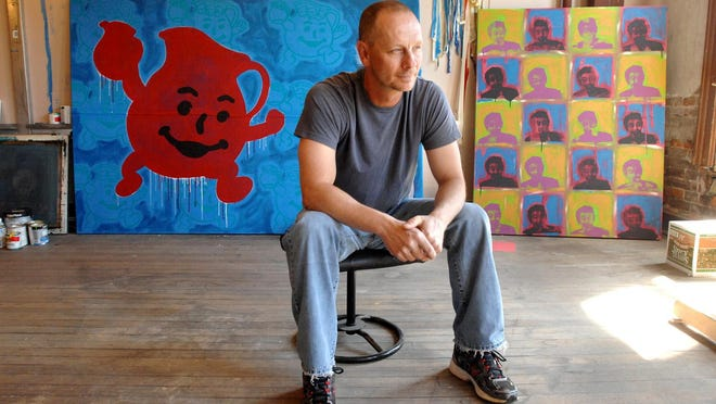 Doug Goessman sits in his art studio in this 2012 Journal Star file photo. The Richwoods teacher and baseball coach also was an artist. He died Sunday at age 51.