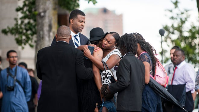 Diamond Reynolds, center wearing black hat, cries outside the funeral of Philando Castile at the Cathedral of St. Paul on July 14, 2016 in St. Paul, Minnesota. Castile was shot and killed on July 6, 2016 by police in Falcon Heights, Minnesota.