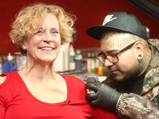 Post CEO Of The Red Robin Chain Gets Her Tattoo Photo