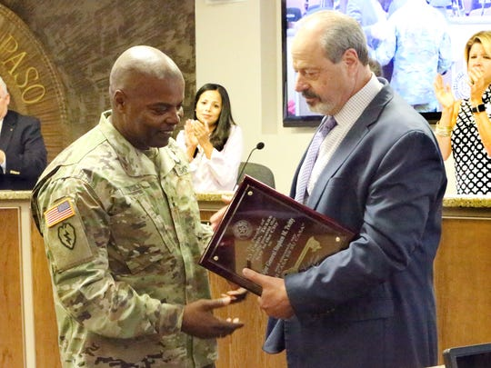 El Paso Mayor Oscar Leeser presents the key to the city to Maj. Gen. Stephen M. Twitty, commander of Fort Bliss and the 1st Armored Division, during Tuesday's City Council meeting. Twitty, who will receive a third star, is leaving Fort Bliss to command First Army in Rock Island, Ill.