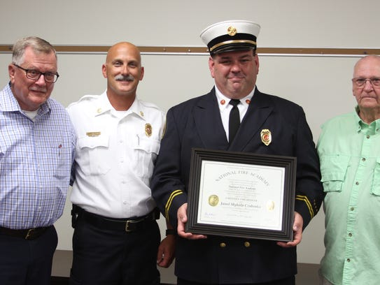 Howell Fire commanders, from left, retired Chief Jim