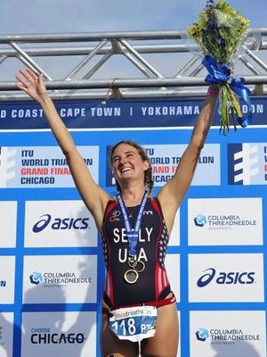 Allysa Seely celebrates on the podium after a paratriathlon event.
