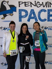 Penguin Pace in Wayne, winners in the women's category, left to right, Jacqueline Murphy (second place), Kate Hyde (winner), Lillian Park (third place).