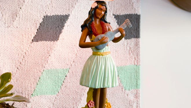 This photo provided by CB2 shows Hawaiian kitsch at its finest, this polyresin hula girl lamp strums just the right retro note. If you spent your childhood summers on a northern lake, grew up lunching at diners and shake shacks, or took a college road trip or two, you?ll be all over the next big home décor trend: American Retro. The imagery and elements can draw Baby Boomers back to what sometimes seem like simpler days.  (AP Photo/CB2)
