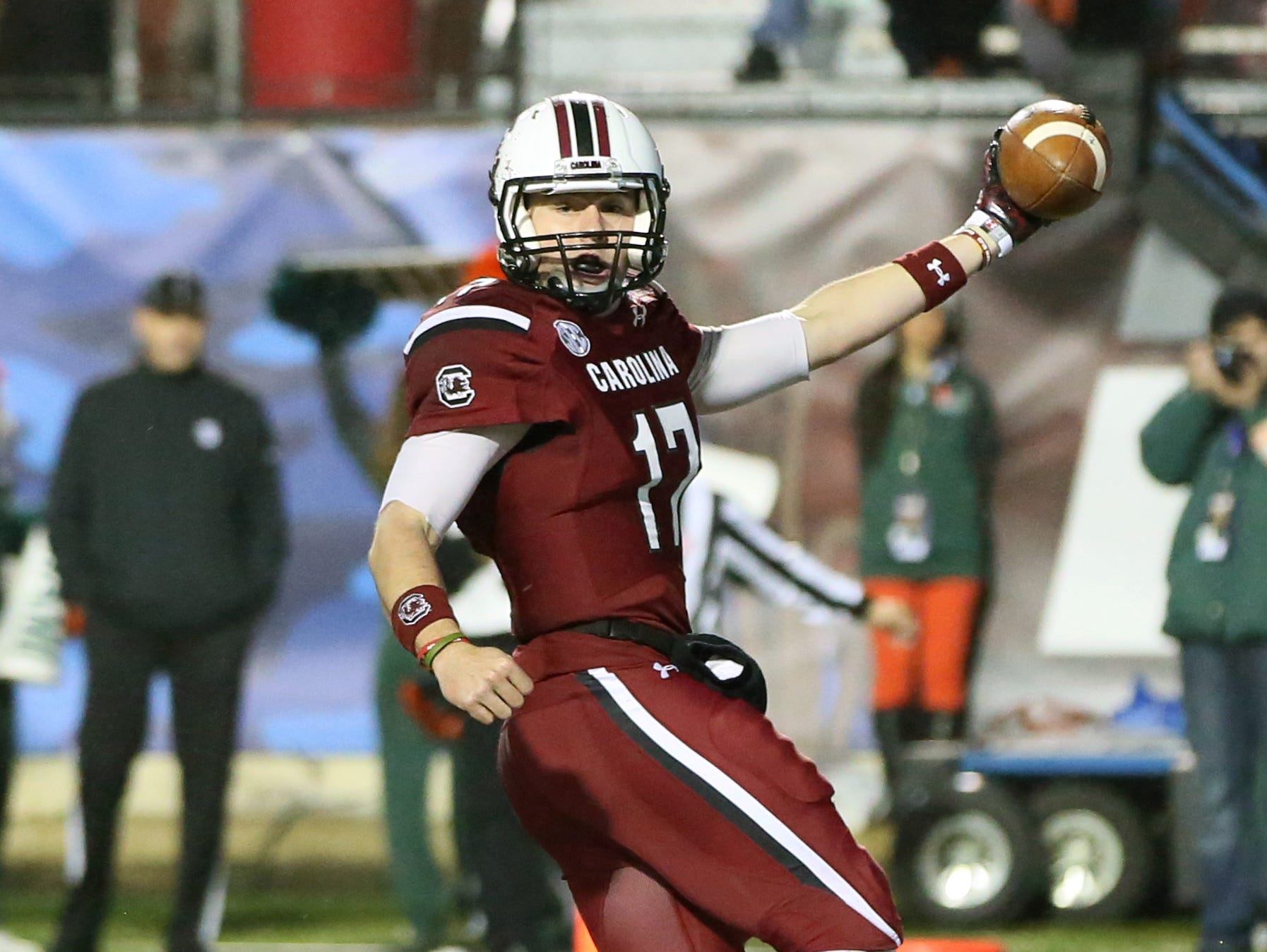 Dec 27, 2014; Shreveport, LA, USA; South Carolina Gamecocks quarterback Dylan Thompson (17) scores a touchdown during the fourth quarter against the Miami Hurricanes in the 2014 Independence Bowl at Independence Stadium. South Carolina defeated Miami 24-21.