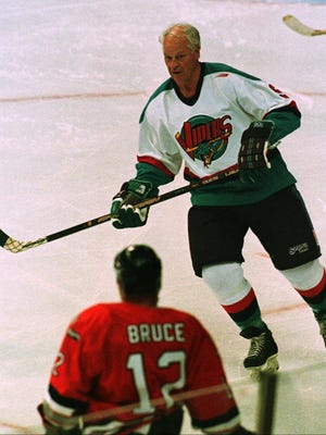 Hockey legend Gordie Howe skates with the Detroit Vipers of the International Hockey League in a game against the Kansas City Blades in Auburn Hills, Mich., on Friday, Oct. 3, 1997. Howe spent 48 seconds on the ice during the first period to become the first professional hockey player to play in six different decades