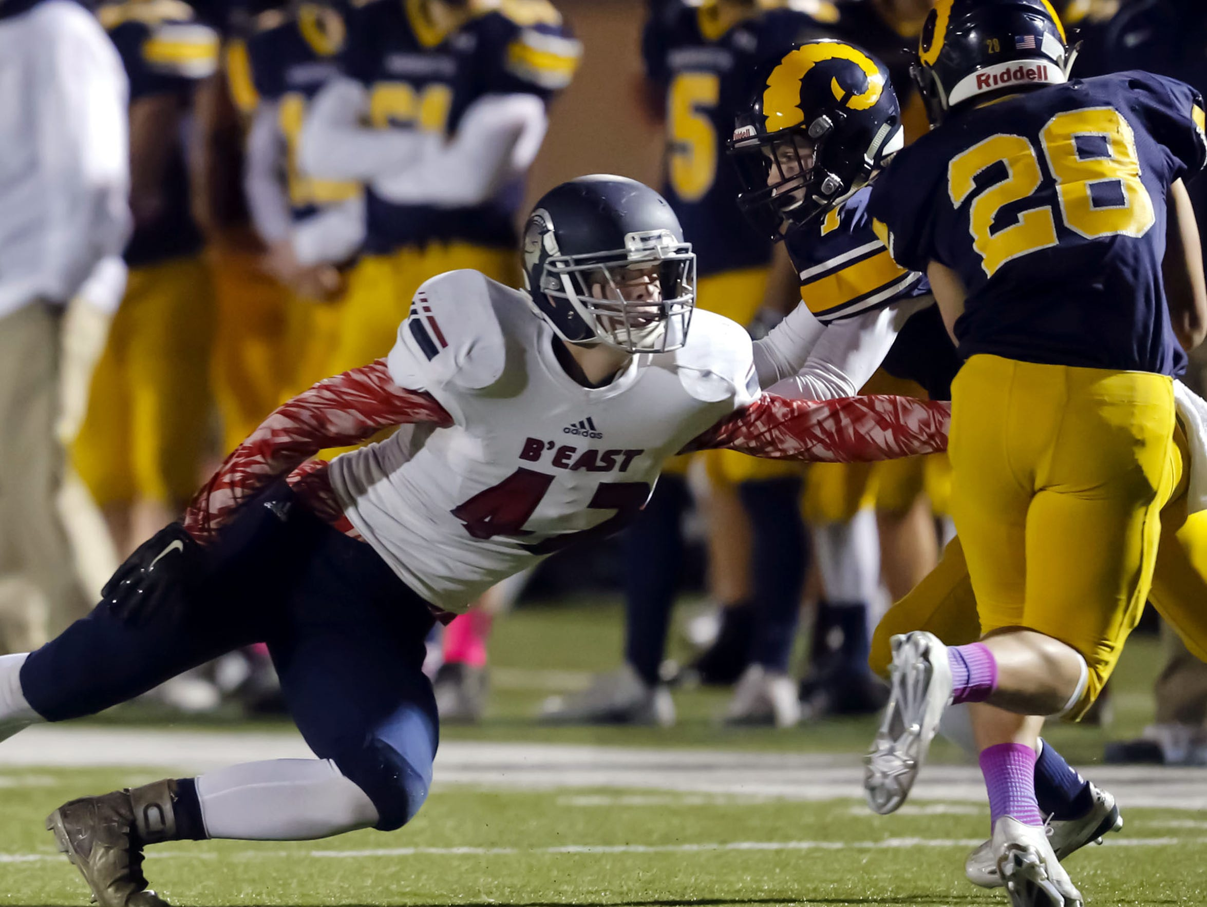 Brookfield East's Jack Steger attempts to tackle Marquette