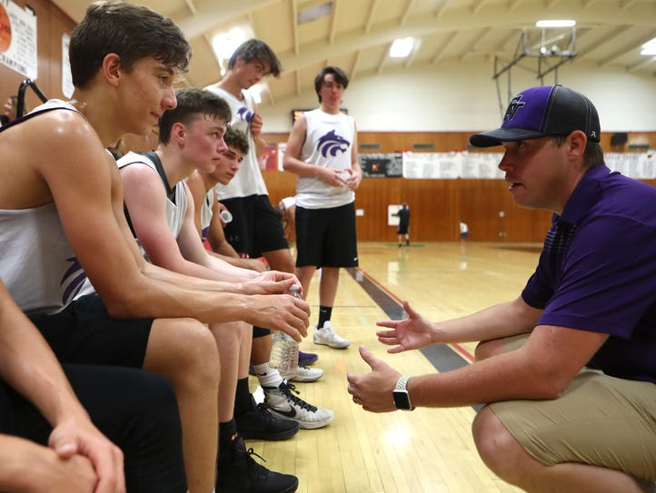 Jordan Freilich, right, coaches members of the Shasta