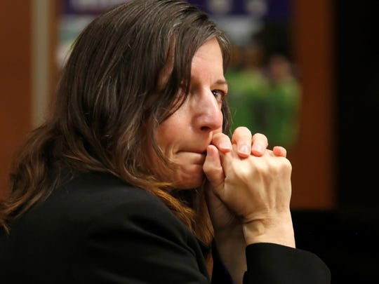 Michelle Lodzinski watches her attorney, Gerald Krovatin, deliver his closing argument in court on Wednesday.