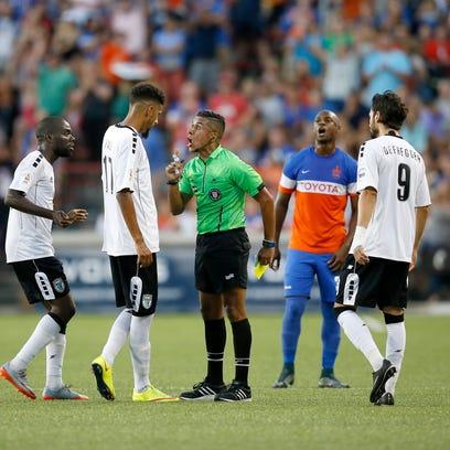 Rhinos midfielder Wal Fall (17) receives a warning