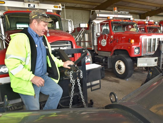 Tom Walburn inspects plows on Wednesday, February 8,