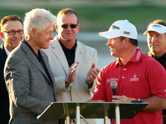 Crystal Chatham/The Desert Sun Operation Iraqi Freedom veteran, amputee, and amateur golfer Chad Pfeifer (right) introduces former President Bill Clinton during the Humana Challenge Military Appreciation Ceremony on Saturday. Operation Iraqi Freedom veteran, amputee, and amateur golfer Chad Pfeifer (right) introduces former President Bill Clinton during the Humana Challenge Military Appreciation Ceremony on Saturday, January 24, 2015 in La Quinta, Calif.