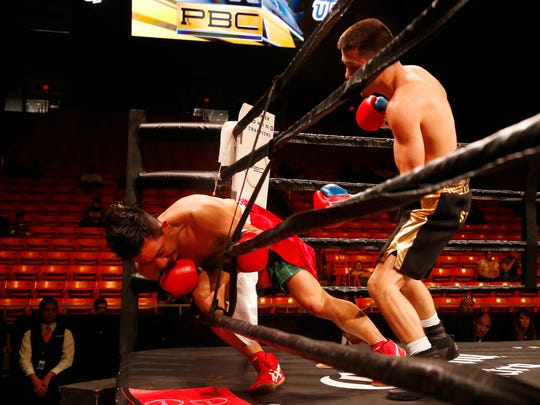 Aaron Morales looks on as Angel Carbajal goes through the ropes during action in their fight Saturday night at the Don Haskins Center. Morales would win the fight by knockout in the fourth round pushing his record to 2-0.