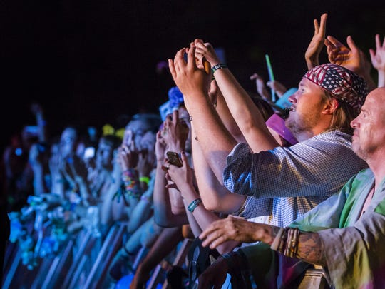 Fans cheer as Florence and The Machine perform on the main stage at Firefly Music Festival in Dover in 2016. The English indie act is the only female-fronted headliner in the festival's seven-year run.