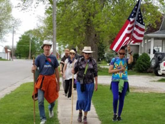Ed Fallon and other environmentalists march across